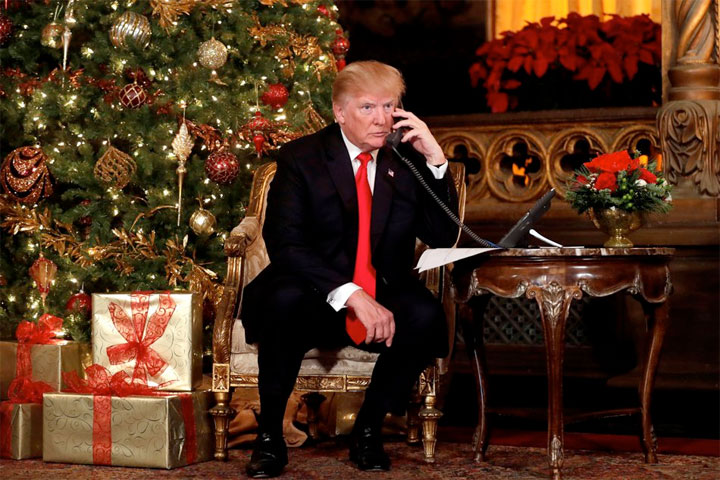 President Donald J. Trump fields calls from children to NORAD's Santa Claus hotline, December 24, 2018