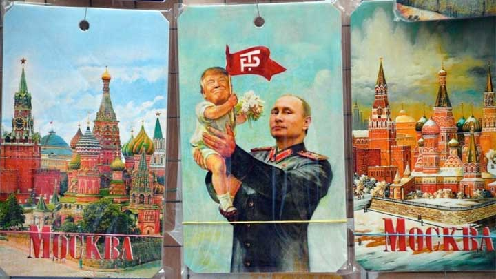 A souvenir kiosk in Moscow offers a drawing depicting Russian President Vladimir Putin holding a baby with the face of U.S. President Trump.