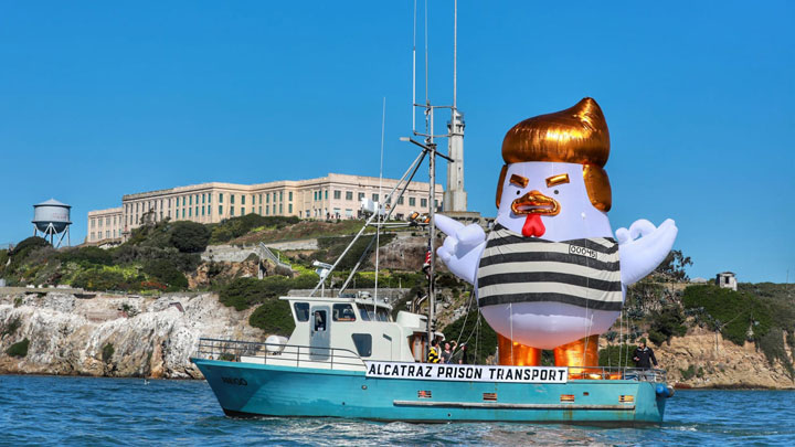 The Trump Chicken, aka Prisoner 00045, a 33-foot inflatable chicken that might look a little like the President being transported to Alcatraz Island.